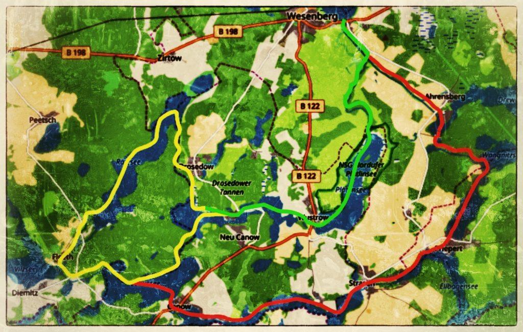 Auf dem Bild ist eine Landkarte zu erkennen. Auf dieser Landkarte sind eingezeichnete farbige Linien die eine Strecke markieren.